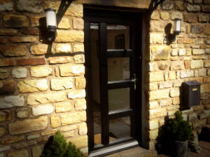 Jet Black Exterior, Golden Oak Interior UPVC Doors